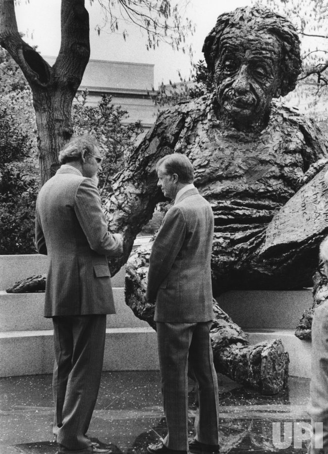 President Carter talks with sculptor Robert Berks in front of Albert Einstein statue