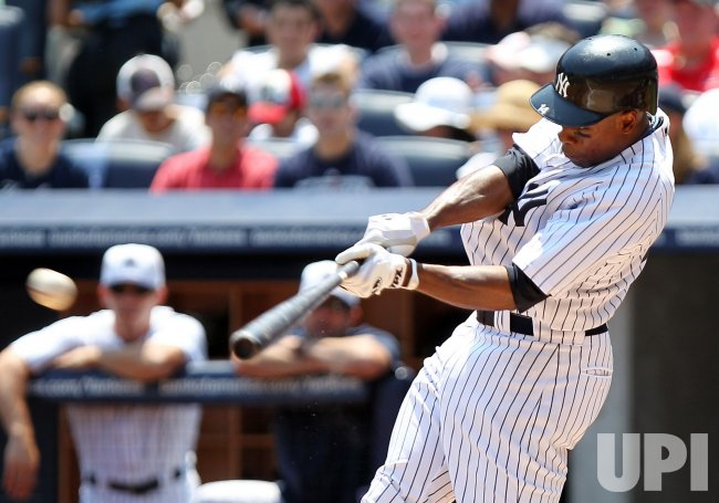 New York Yankees Curtis Granderson hits a double at Yankee Stadium in New York