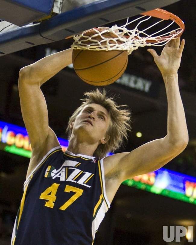 Utah Jazz Andrei Kirilenko slams home two against the Golden State Warriors in Oakland, California