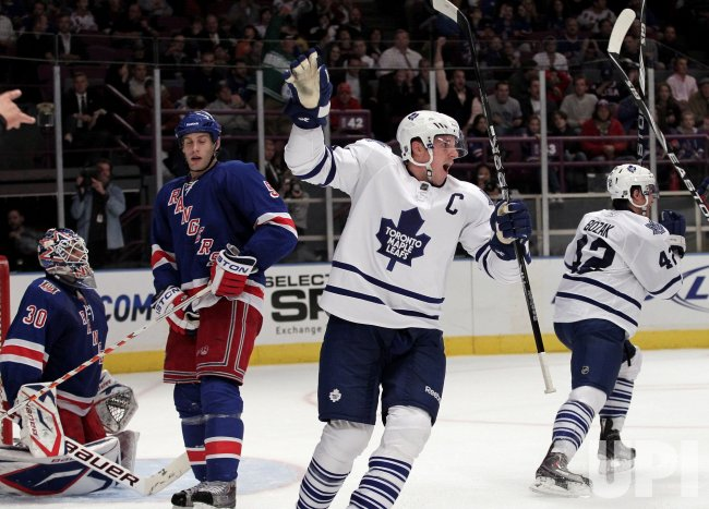New York Rangers Dan Girardi and Henrik Lundqvist react as Toronto Maple Leafs Dion Phaneuf and Tyler Bozak celebrate at Madison Square Garden in New York