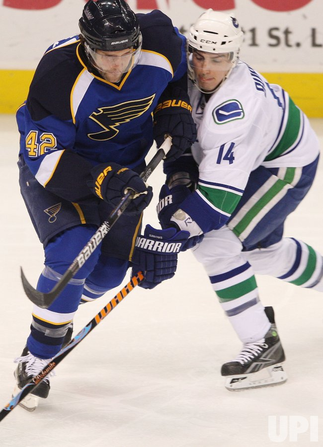 Vancouver Canucks Alexandere Burrows and St. Louis Blues David Backes