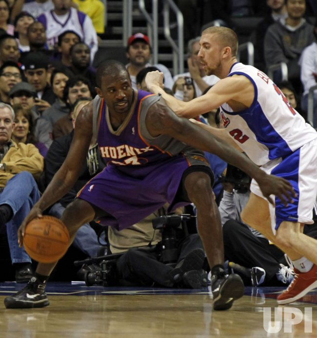 Suns Jason Richardson is guarded by Clippers Steve Blake in Los Angeles