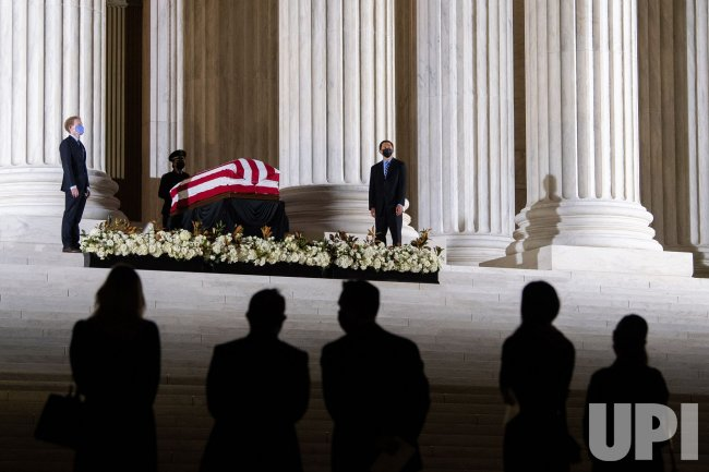 Justice Ruth Bader Ginsburg lines in repose at the Supreme Court