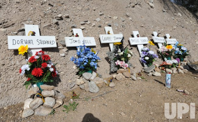 Crosses honor the dead on the anniversary of the shootings in Tucson, Arizona.