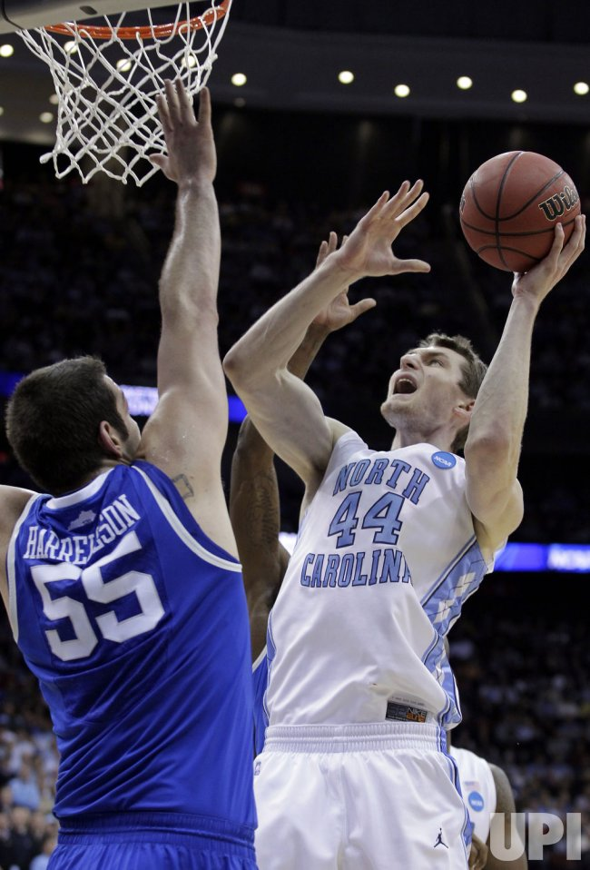 Kentucky Wildcats Josh Harrellson plays defense on North Carolina Tar Heels Tyler Zeller at the Prudential Center in New Jersey