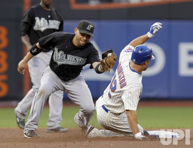 New York Mets Scott Hairston is caught stealing and tagged out by Florida Marlins Hanley Ramirez at Citi Field in New York