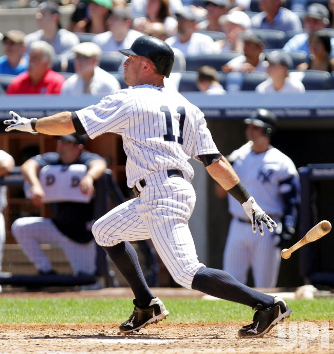 New York Yankees Brett Gardner hits a grand slam home run at Yankee Stadium in New York