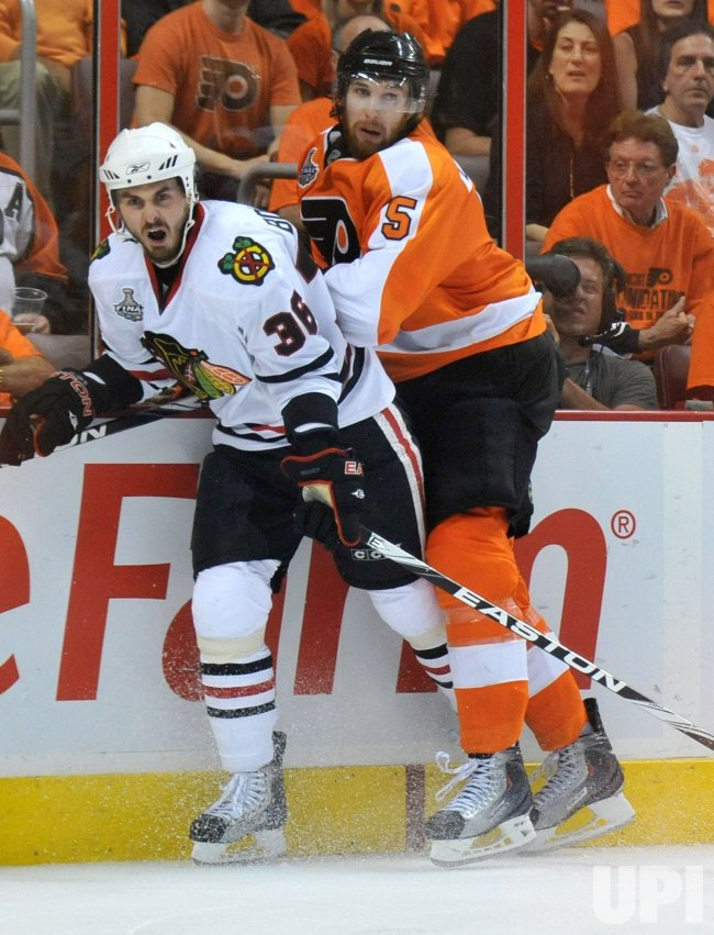 Flyers Braydon Coburn holds Blackhawks Dave Bolland during the 2010 Stanley Cup Final