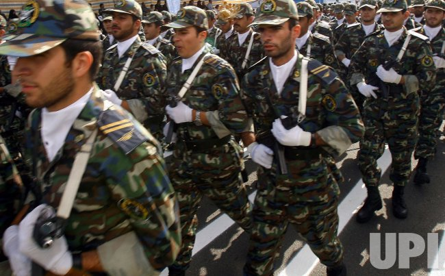 Iranian military forces parade during Iran's defense week
