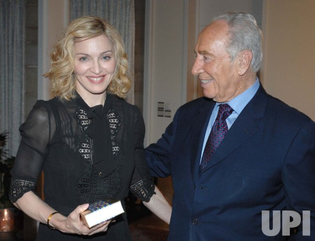 MADONNA GIVES KABALA BOOK TO ISRAELI PRESIDENT IN JERUSALEM