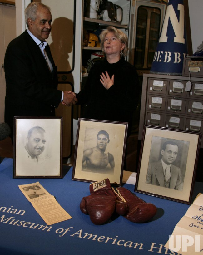 BOXING GLOVES OF HEAVYWEIGHT CHAMPION JOE LOUIS ARRIVE AT NATIONAL MUSEUM OF AMERICAN HISTORY