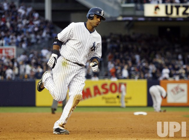 New York Yankees Robinson Cano runs the bases after hitting a solo homer against the Boston Red Sox at Yankee Stadium in New York