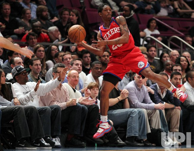 Spike Lee reacts as Philadelphia 76ers Louis Williams leaps at Madison Square Garden