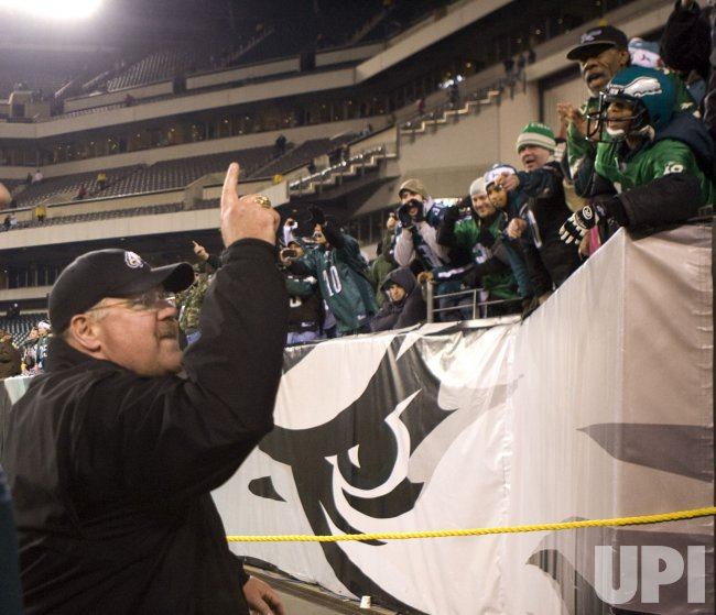 Philadelphia Eagles head coach Andy Reid gestures to fans