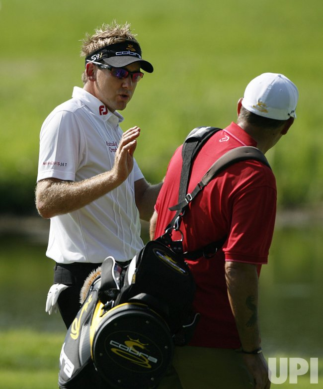 Ian Poulter (L) talks with his caddie during his practice round before the 91st PGA Championship in Chaska, Minnesota