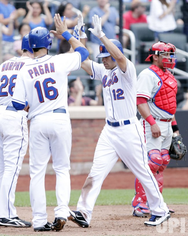 Philadelphia Phillies Carlos Ruiz stands at the plate as New York Mets Scott Hairston celebrates his 3-run home run with Angel Pagan at Citi Field in New York