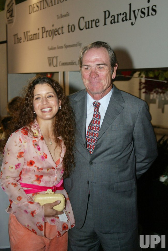 ACTOR, TOMMY LEE JONES WITH WIFE, DAWN MARIA LAUREL ATTEND A MIAMI PROJECT TO CURE PARALYSIS FASHION SHOW BENEFIT