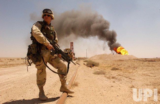 Oil well fires still burn in southern Iraq
