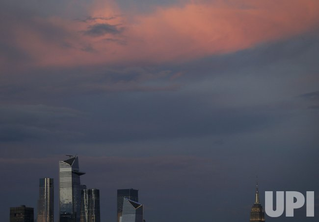 Sunset Over The Empire State Building and Manhattan Skyline