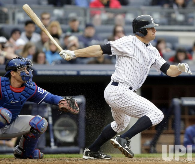New York Yankees Brett Gardner hits an infield single at Yankee Stadium in New York