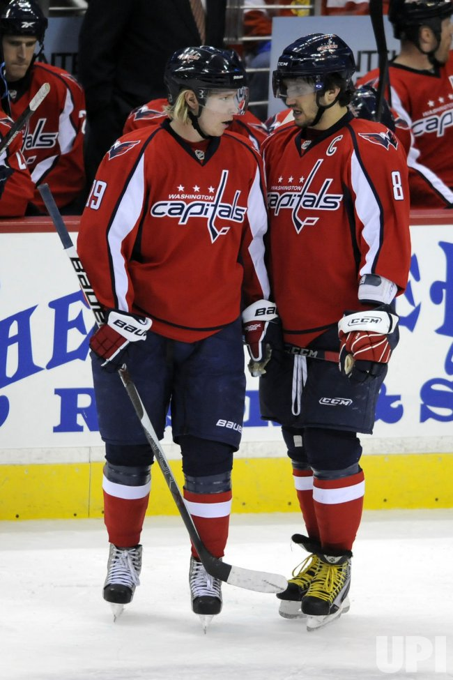 Team Captain Alex Ovechkin talks with Nicklas Backstrom in Washington, DC