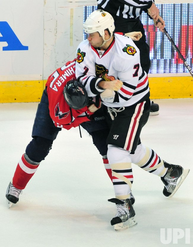 Chicago Blackhawks' Brent Seabrook fights with Washington Capitals' Jason Chimera in Washington