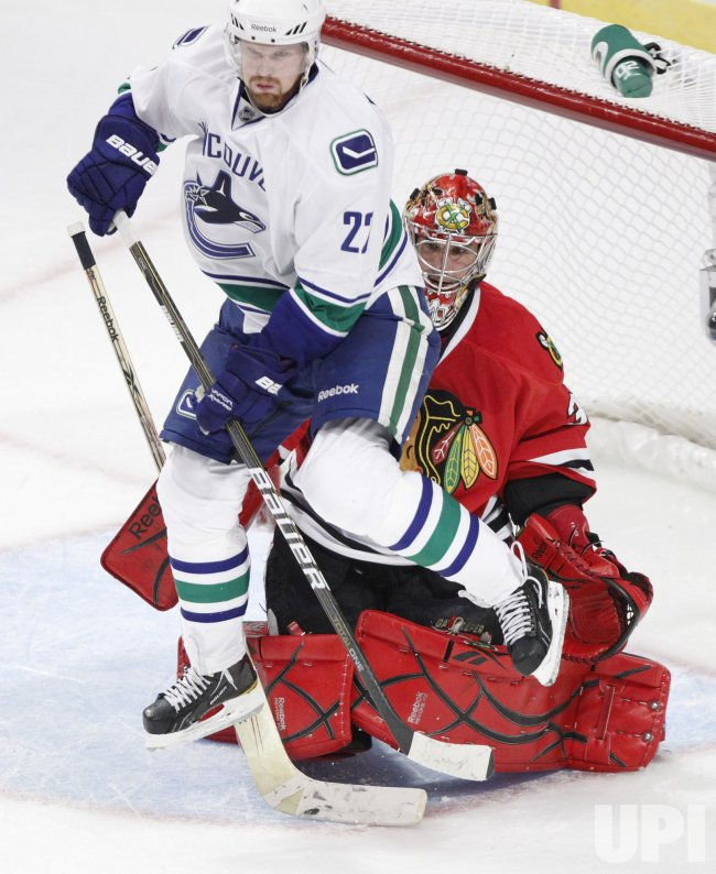 Canucks Sedin jumps against Blackhawks in Chicago