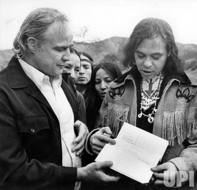 MARLON BRANDO GIVING LAND TITLE TO HANK ADAMS