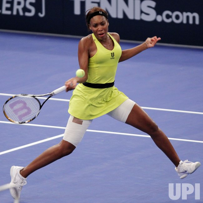 Venus Williams hits a forehand in her match against Kim Clijsters at Madison Square Garden in New York