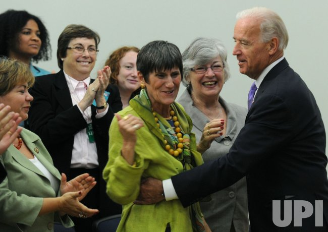 Vice President Joe Biden hugs Rep. Rosa Delauro (D-CT) in Washington