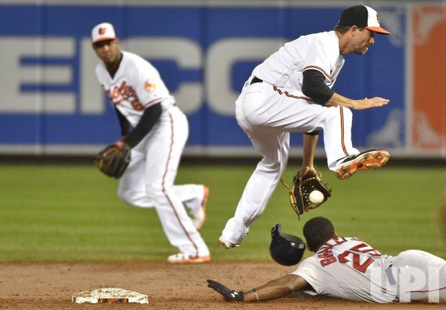 Boston runner Jackie Bradley Jr. safely steals second base under Baltimore shortstop J.J. Hardy