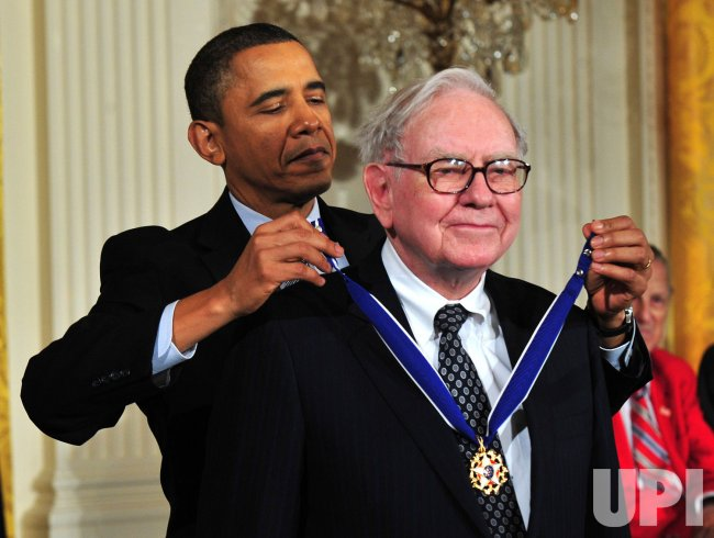 President Barack Obama awards the 2010 Medal of Freedom to Warren Buffet in Washington