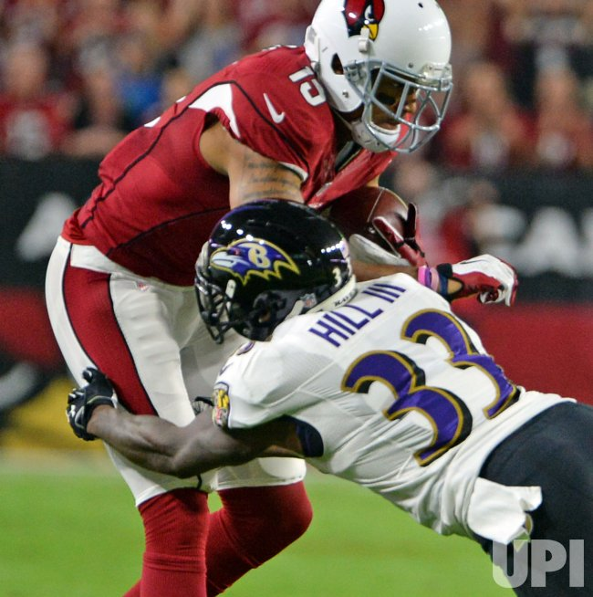 Cardinals Floyd is hit by Ravens Hill III after a first down