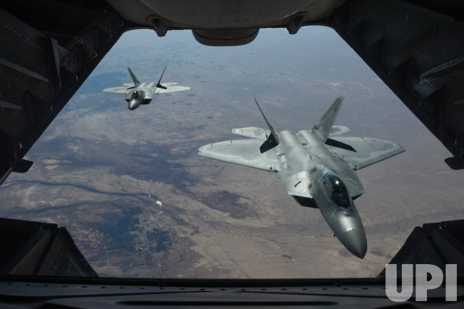 US airstrikes kill more than 100 fighters in Syria