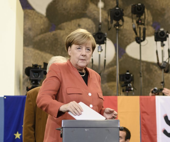 Merkel wins fourth term; far-right party wins first parliament seats