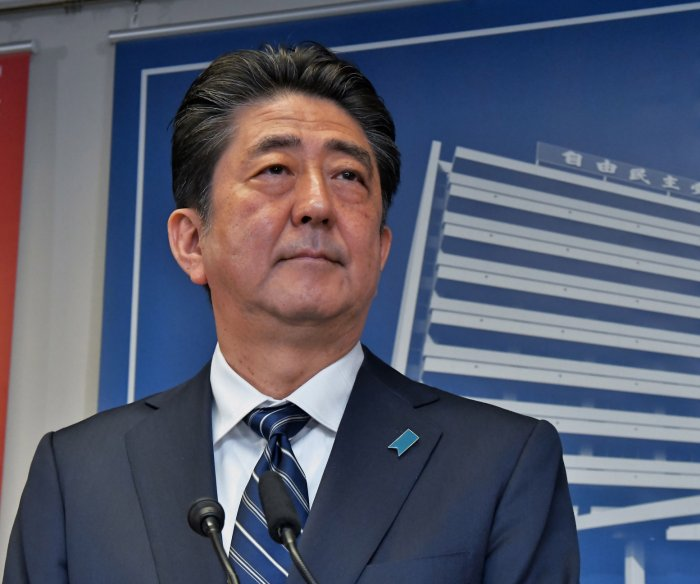 Japan's Abe outlines top priorities after party's election win