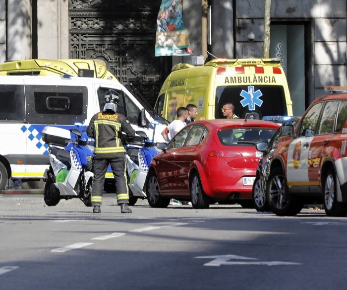 At least 1 dead after van hits Barcelona crowd; terrorism suspected