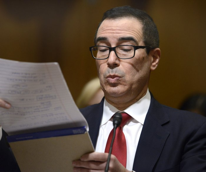 Treasury pick Mnuchin fights questions about tax shelters, 'foreclosure machine'