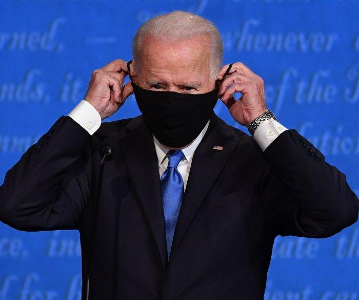 Biden promises to 'shut down the virus' in Iowa drive-in rally