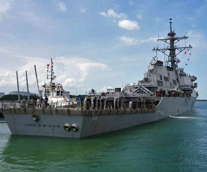 USS John S. McCain at base after collision; 10 sailors missing