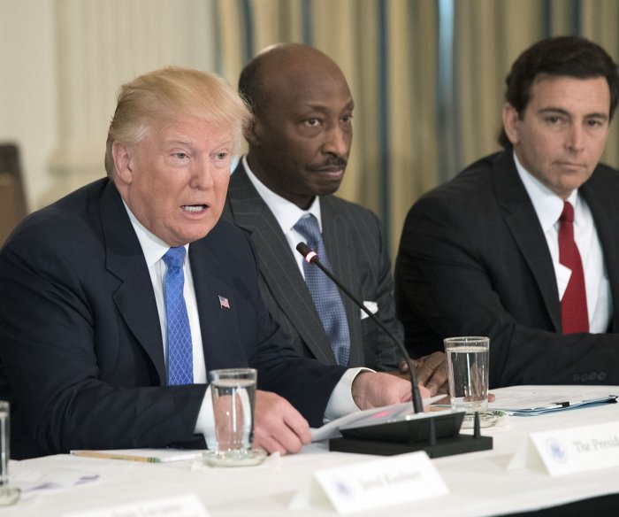 Trump shuts down business councils as CEOs leave