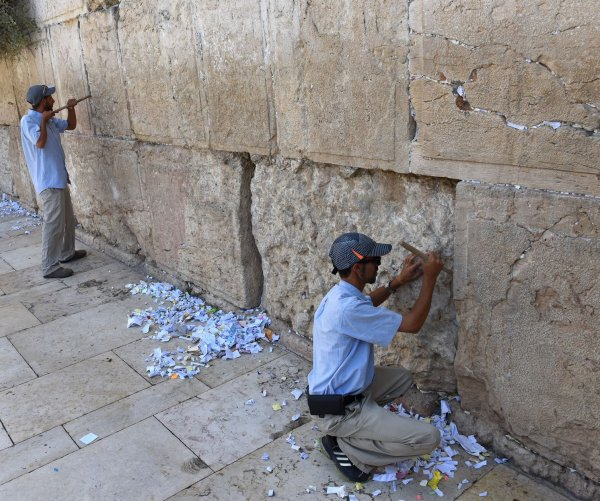Workers clear prayer notes from Western Wall before Rosh HaShanah