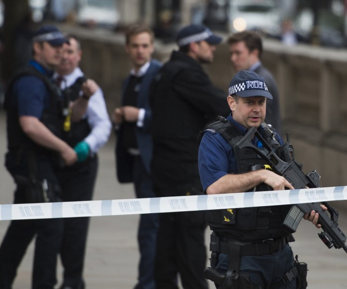 London police shoot woman, arrest six in counter-terror raid