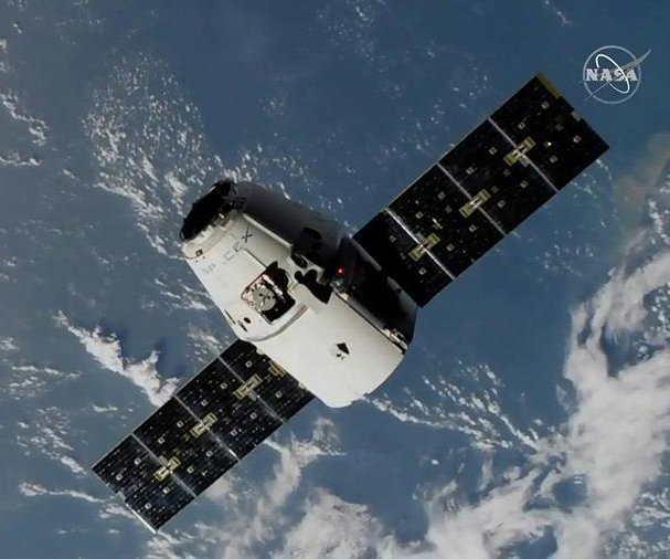 SpaceX Dragon docks with International Space Station