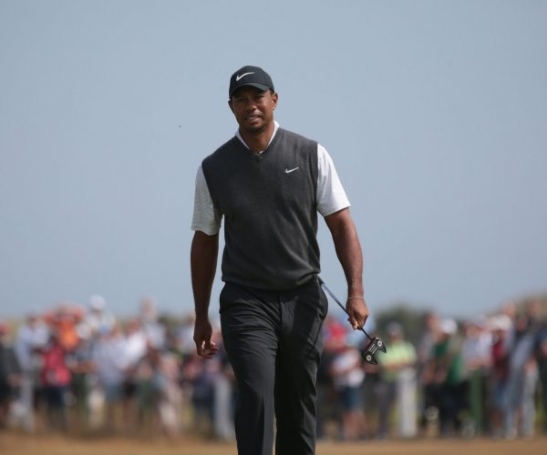 British Open: Tiger makes charge, Spieth earns share of lead