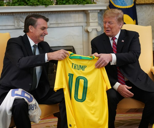 Trump, Bolsonaro vow fight against socialism