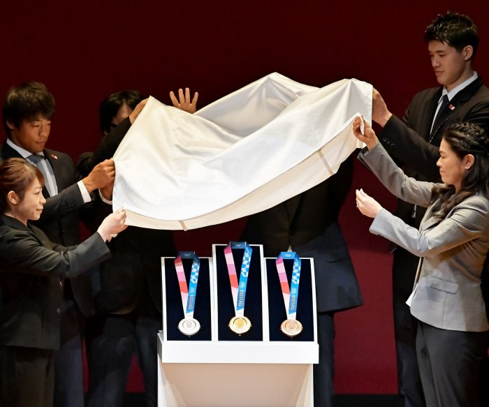 Olympic medals are unveiled at ceremony in Tokyo
