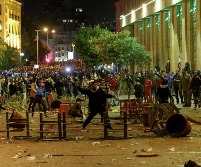 Lebanon marks first year of uprising, sees long road to change
