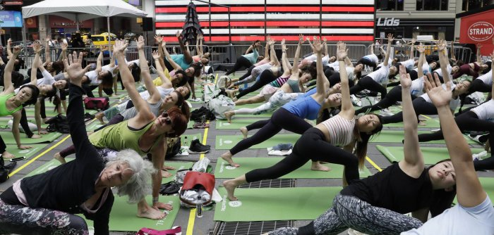 Thousands celebrate summer solstice with yoga in Times Square