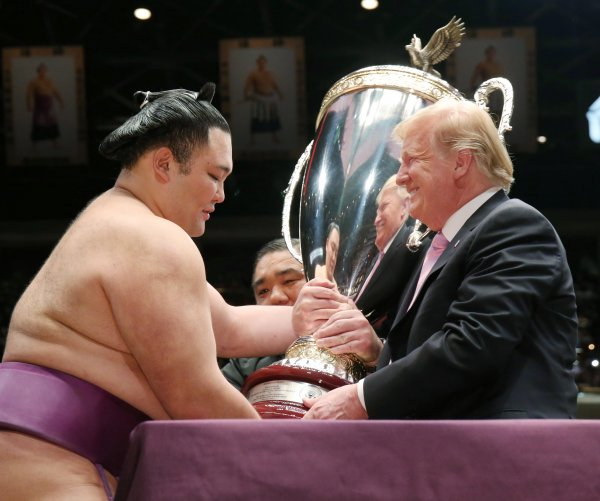 Trump's day with Abe: Golf, sumo wrestling, three meals, diplomacy